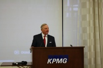 Judge Sven Erik Holmes welcomes WNSF Summit participants to KPMG